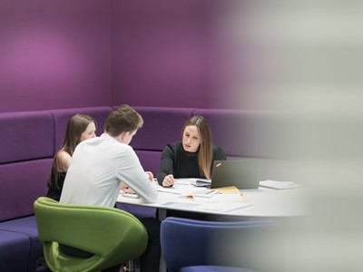 Business meeting in purple break-out area