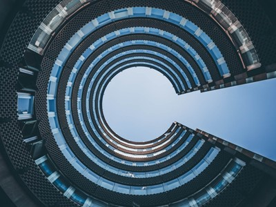 Modern office building architecture looking up at circular structure