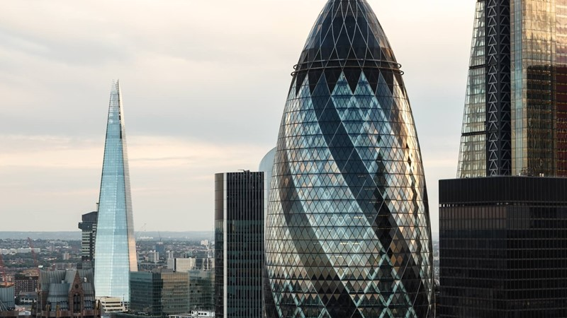 Cityscape of London at duck with Gherkin building in focus